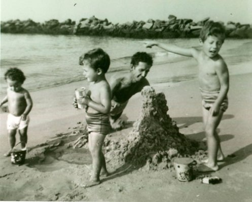 Woody with the kids on the beach at Coney Island, circa 1954.